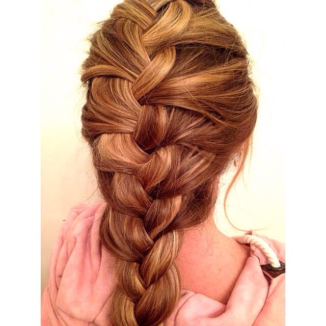 Just a simple Dutch braid. Don't know how? It's simple! It's exactly like a French braid, but in reverse. Don't know how to French braid? Just take a section of hair from the front and braid it like normal and continue adding pieces of hair to the side pieces and braid them in. As easy as 1 2 3!