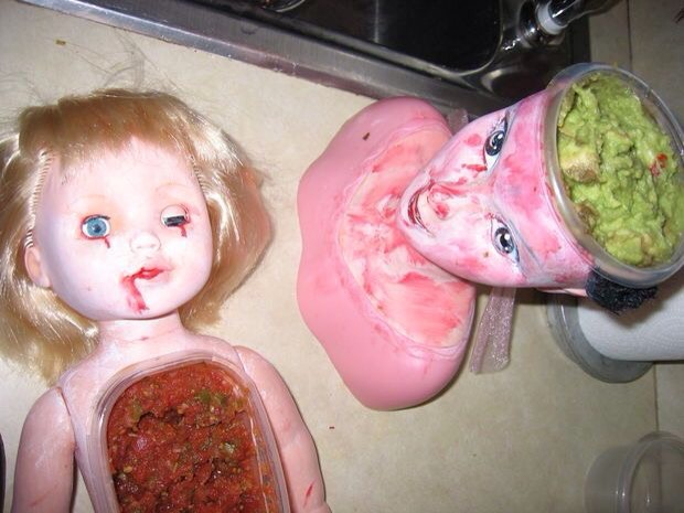Find some old dolls or doll heads and cut them to fit a dish of food and make them all creepy looking, cut their hair, use fake blood