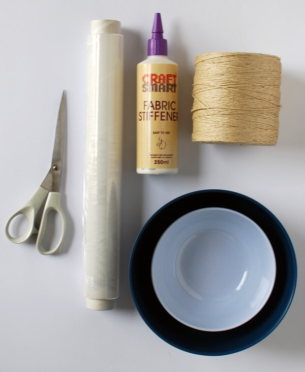 Supples: • 250ml bottle of fabric stiffener. • Ball of string. • Cling film. • Scissors. • Small bowl for fabric stiffener. • Large bowl to use as a mould.