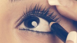 Line your top water line to make the base of your lashes darker and seem thicker