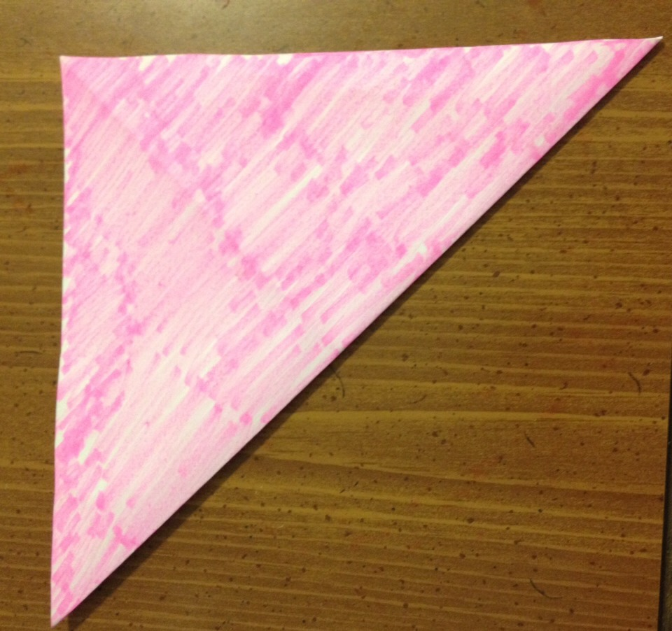 Fold the other way to make a triangle like this and then unfold again.