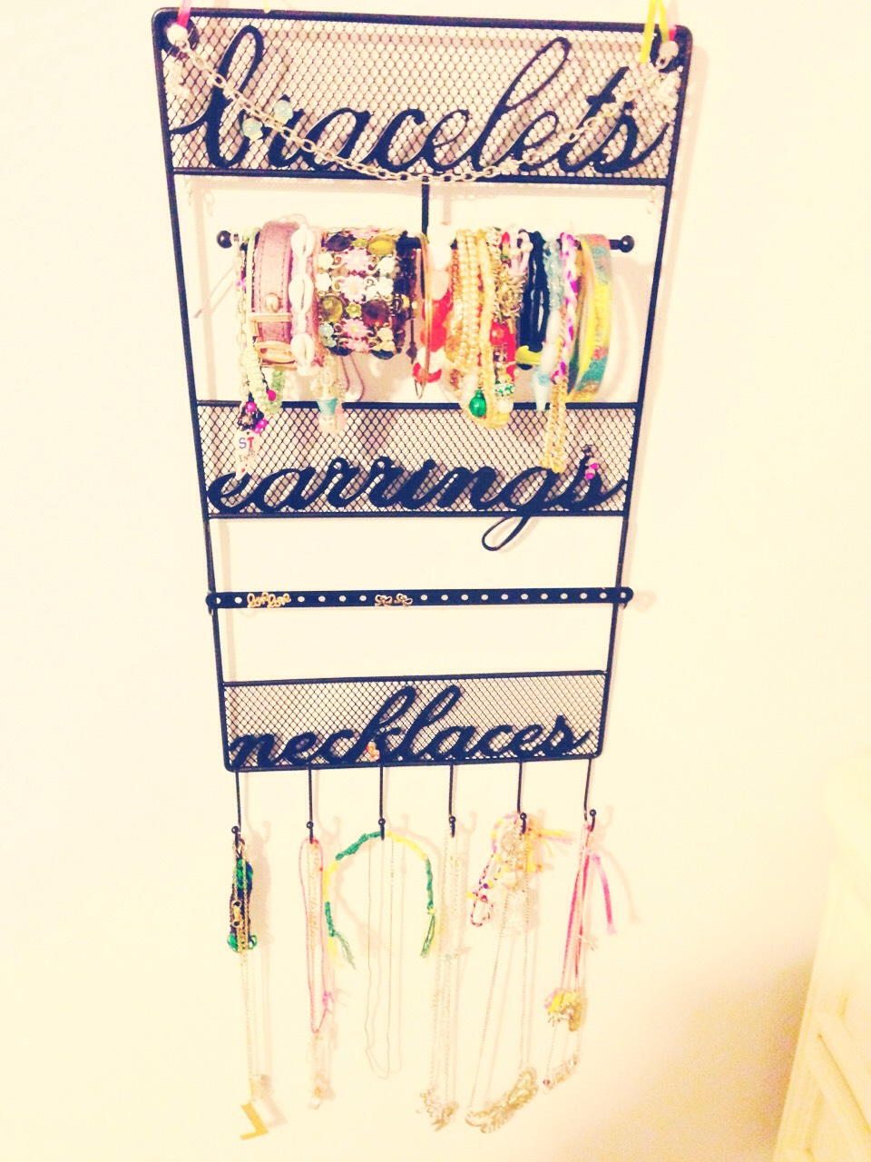 You can buy one of these jewelry holders at Claire's, icing, ect , but I got mine at Michaels craft store