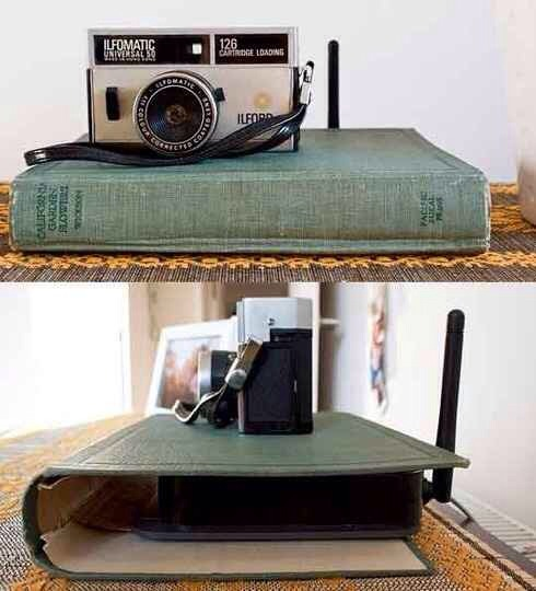 5. Use a hollowed out book to hide an unsightly router.