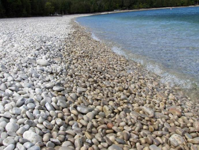 Schoolhouse Beach This beach is covered with smooth limestone rocks that nicely massage one's feet while walking. This beach is located in Washington Island, Wisconsin, USA.