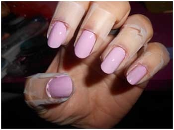 Put tape around your nails to avoid getting a lot of the polish on your skin