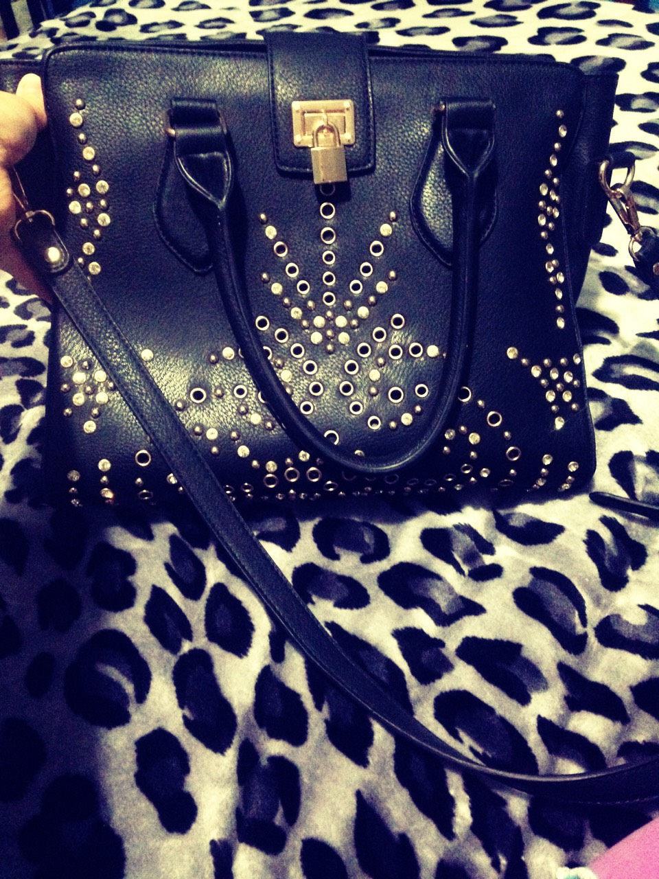 This is my ZIARA bag and its in the color black realy big and pretty. It has nice touches such as  fashion diamonds and the studs has a long strap as well  Got it for only $65  Can find it o. Ebay & Amazon