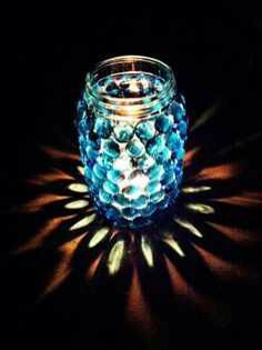 Superglue Glass Marbles to a Mason Jar and stick a candle in it for a cool votive!