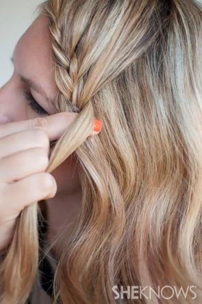 Angle the braid right onto your face and in front of your hairline. You want the braid to sit grazing along the edge of your eyebrow, coming down the left side of your face.