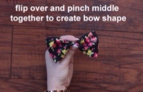 Fold halfway and pinch the middle to create the bow look 👀