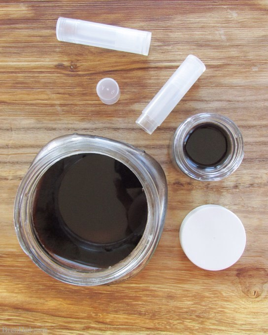 Carefully pour the mixture into clean lip balm pots, tubes or tins + allow to cool completely.A slight depression will form in the center asbalm cools;you can reserve somebalm to fillcenter if you want. Simply leave 1-2tspof balm inglass jar + reheat it to add to the tubes or pot.