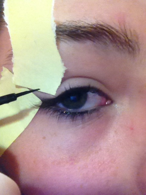 Then you take your eyeliner and fill in your skin the is showing.
