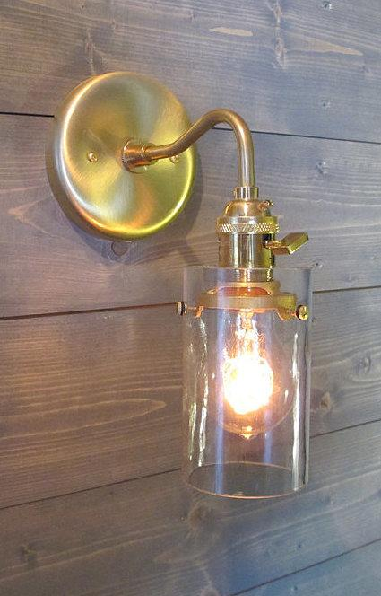 A Stylish Scone A recycled bottle, once modified slightly, can make a beautiful and understated wall sconce.