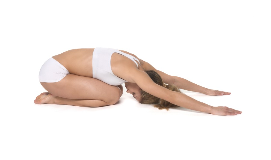 Child's pose: kneel on the mattress and allow your big toes to touch. Widen your knees as far as you comfortably can and lie down between your thighs. Stay in this pose for as long as you'd like- it's restorative.