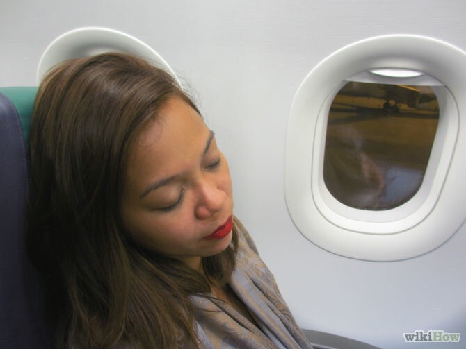 Try to sleep on the plane! It also helps relax that tight stomach and gets your mind off the fact that you may trow up