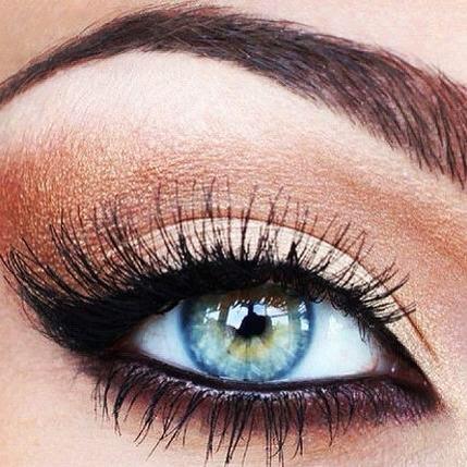 copper and black eye makeup, blue eyes pop.