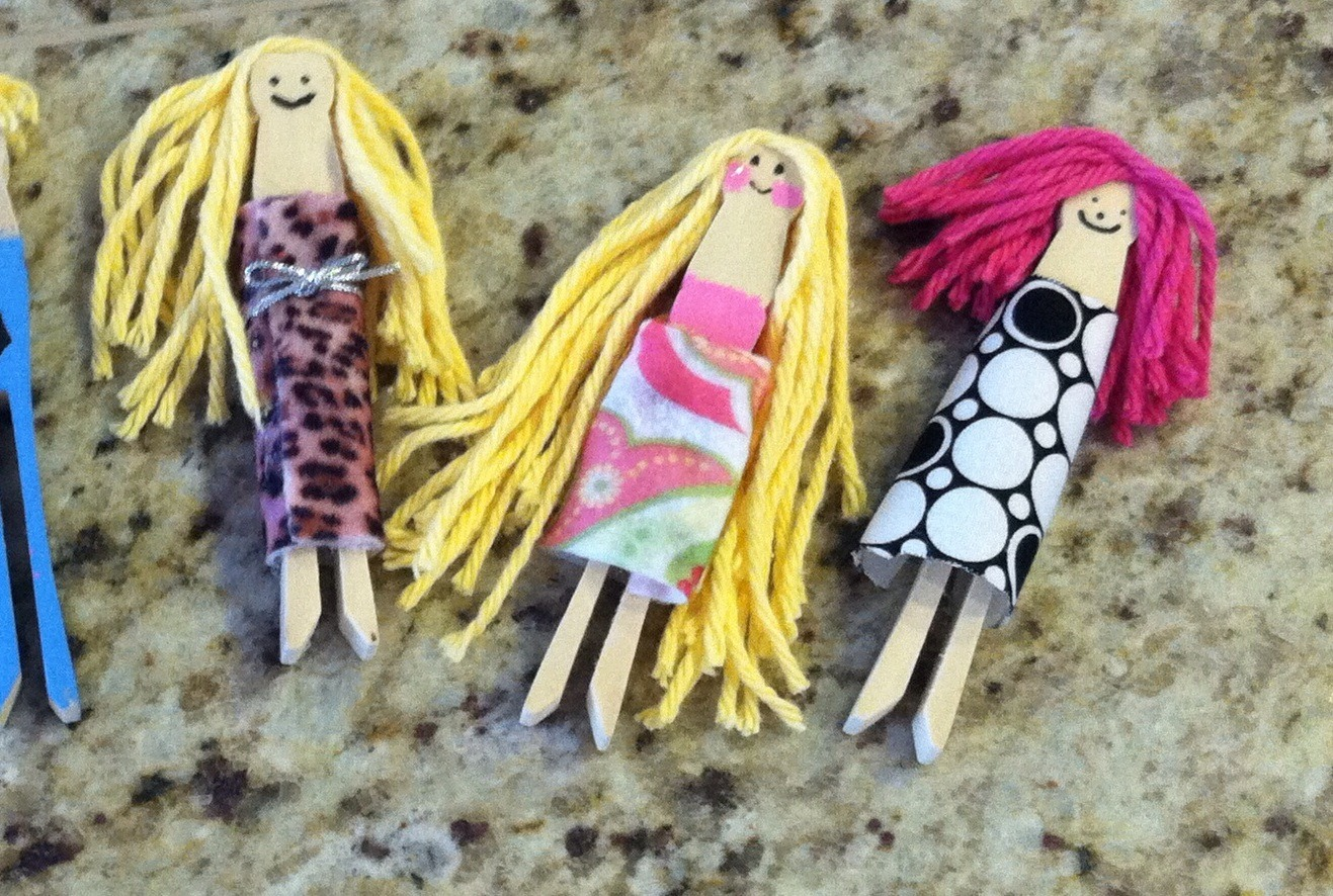 All you need is large clothespins, felt 29cents a page at craft store, yarn for hair, hot glue, and markers and optional acrylic paints