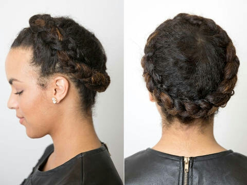 Part your hair down the center. Starting at the nape of your neck on your left side, begin creating an inverted French braid following your hairline. Continue doing so the entire way around your head until you've braiding all your hair. Finally, tuck the secured ends under the braid and you're done!