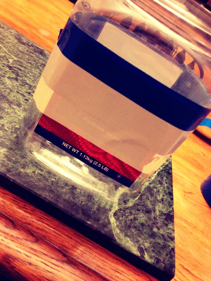 3. Take the white duct tape and wrap it around jar once, overlapping around on the blue