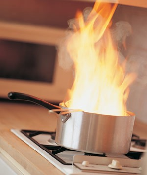 Throw baking soda on a burgeoning grease fire. It works much like a powder fire extinguisher. But don't use water, baking powder or flour, as it's likely to make the fire even bigger.