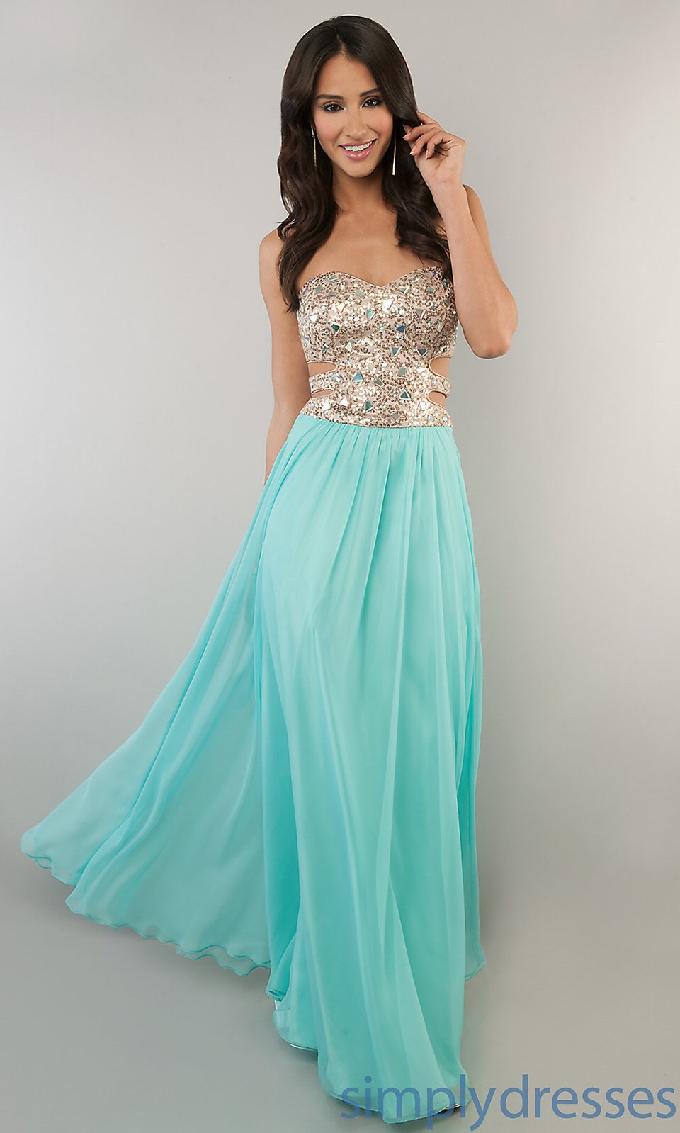 I love how it has turquoise jewels at the top blended with the gold