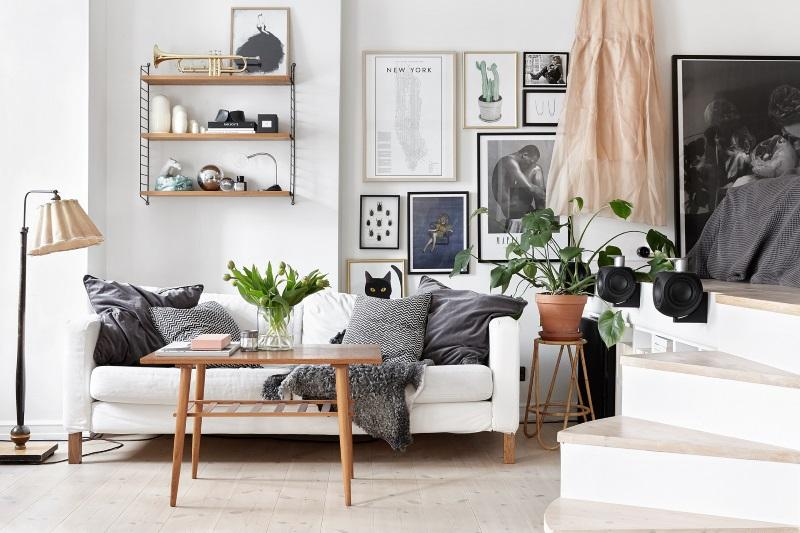 Strategically place your art Placing art above your eye line can create a sense of height and space in a small room. Start with your largest piece, then add a cluster of three or four smaller framed pieces around it that will be an instant eye grabber and make the room like way bigger.