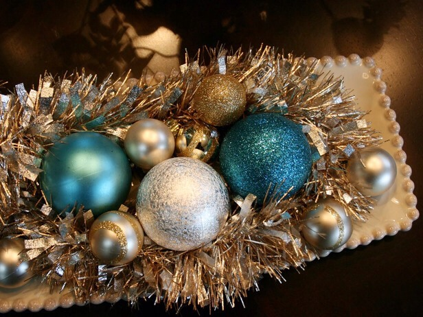 Silver Bells Layer garland with a collection of colorful ornaments in your favorite tray to create an irresistible holiday centerpiece. Dress up a vintage-inspired porcelain tray with bold accessories and uses a mixture of silver, blue and gold hues for a twist on the traditional red