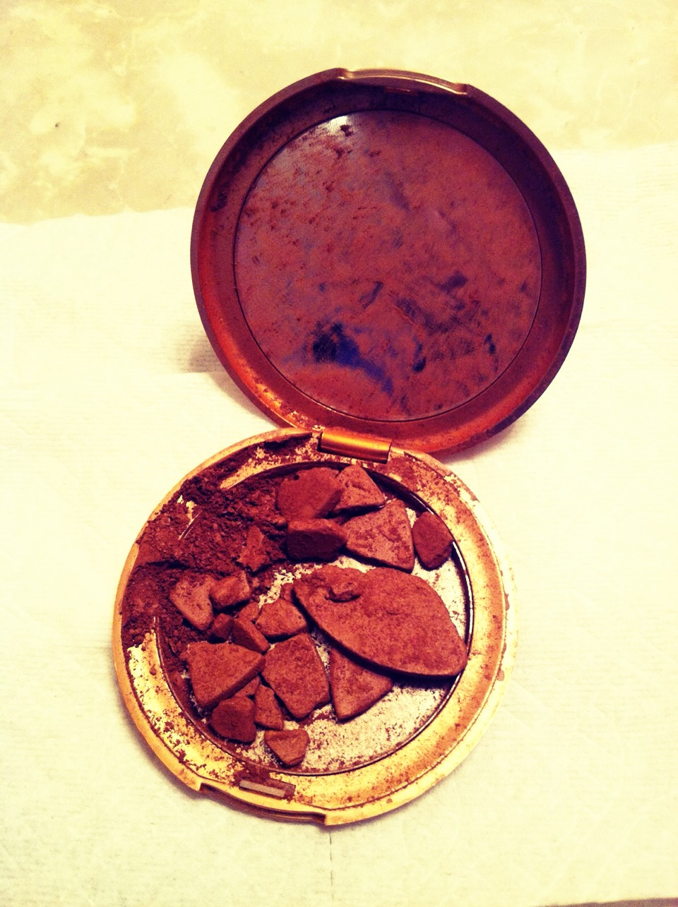 Shattered your favorite makeup? Mix with rubbing alcohol until it turns to 'batter', once mixed, cover with Saran Wrap and press back into shape with a coin