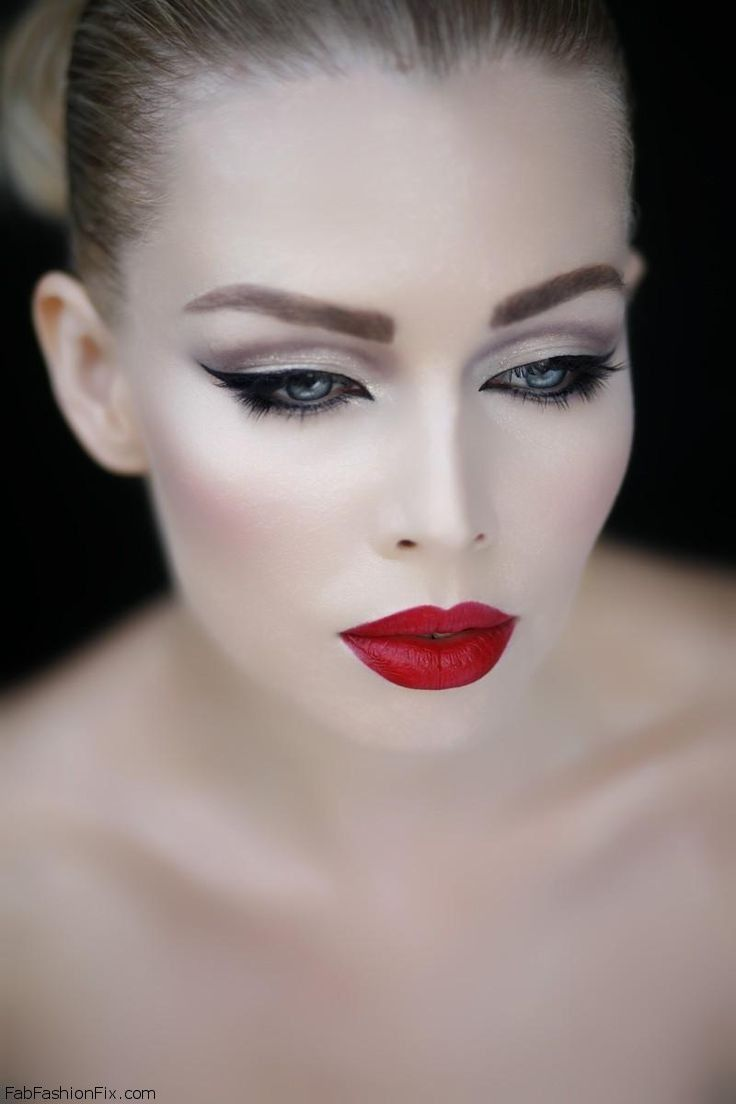 bold red lip, white lids, and winged eyeliner