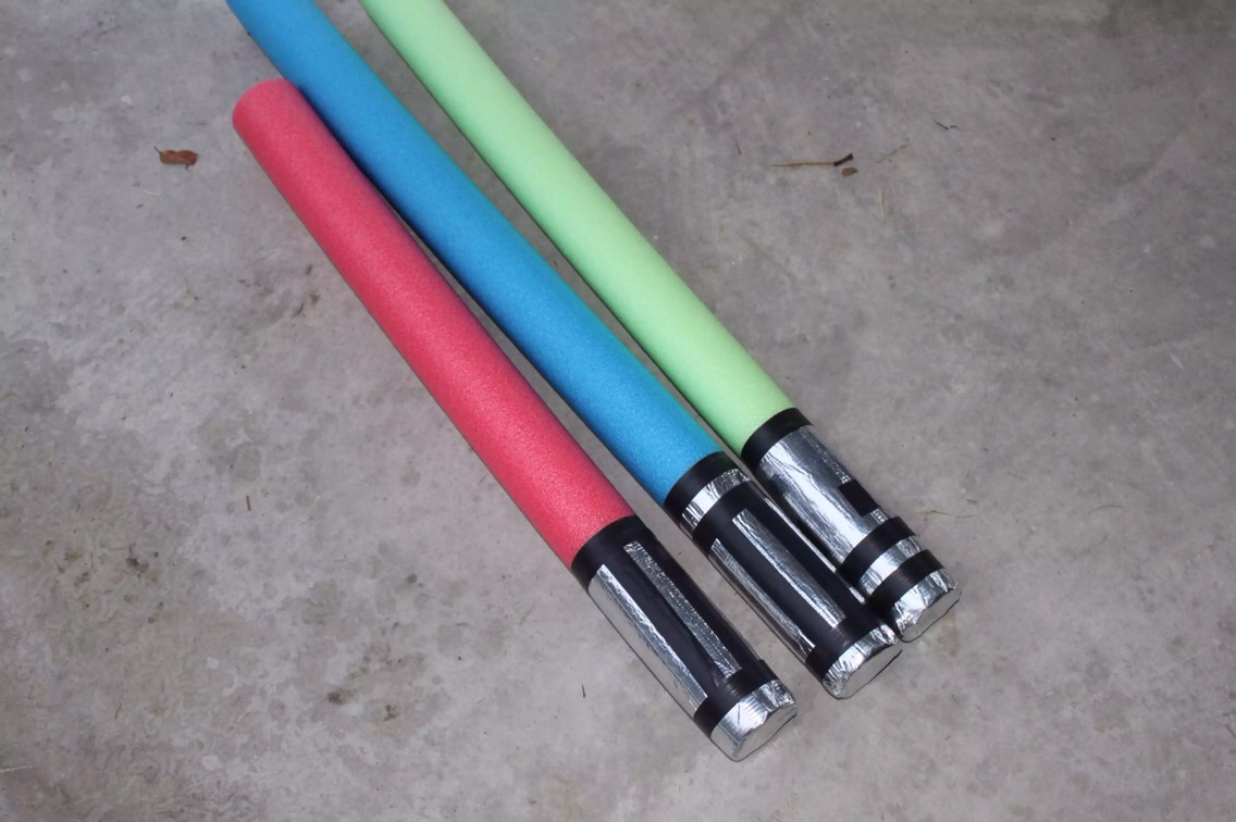 LIGHT SABERS!!  An easy DIY to make at home with duct tape and a pool noodle