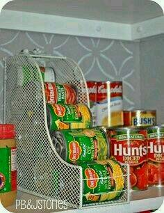 Use a magazine rack to stack tins