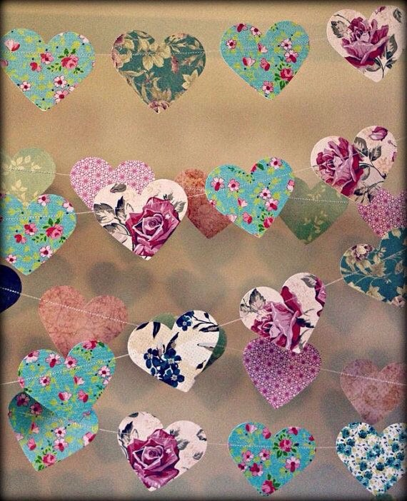 Cut any shape you want. Circle/hearts/flowers Place glue on the back. Attach string.  Hang!!!!