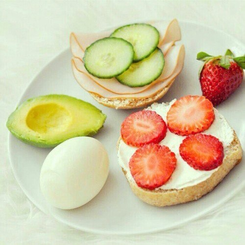 Boil one egg. Slice one strawberry and lay on top of your cream cheese spread. On the other half of the bagel get a cucumber an slice a couple pieces on top of the turkey. On the side half of an avocado.