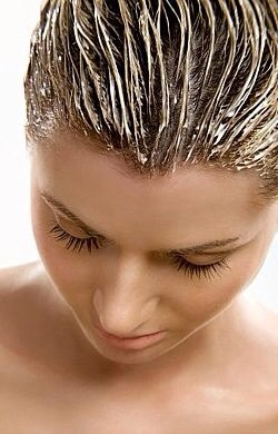Mix 2 egg yolks with 2 tablespoons of olive oil, then dilute the mixture with about half a cup of water. Slowly, thoroughly massage the resulting mask into your scalp. After letting it set for 15-20 minutes, rinse it out as usual. You can shampoo afterward if you want to but it's not necessary.
