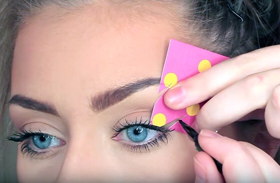 What you need ~ An old business card or cardstock paper, and scissors  What to do ~ Cut your desired size and shaped triangle on the edge of the card, place up to the edge of your eye and carefullyfill the open gap with eyeliner!