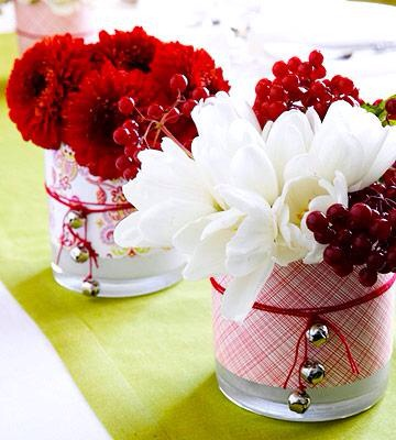 Floral fun  Enliven basic glass vases with Christmas-color scrapbooking papers. Simply cut papers to fit around the vases and secure with double-sided tape. Tie red string (with silver bells attached) around the vases and insert winter bouquets.