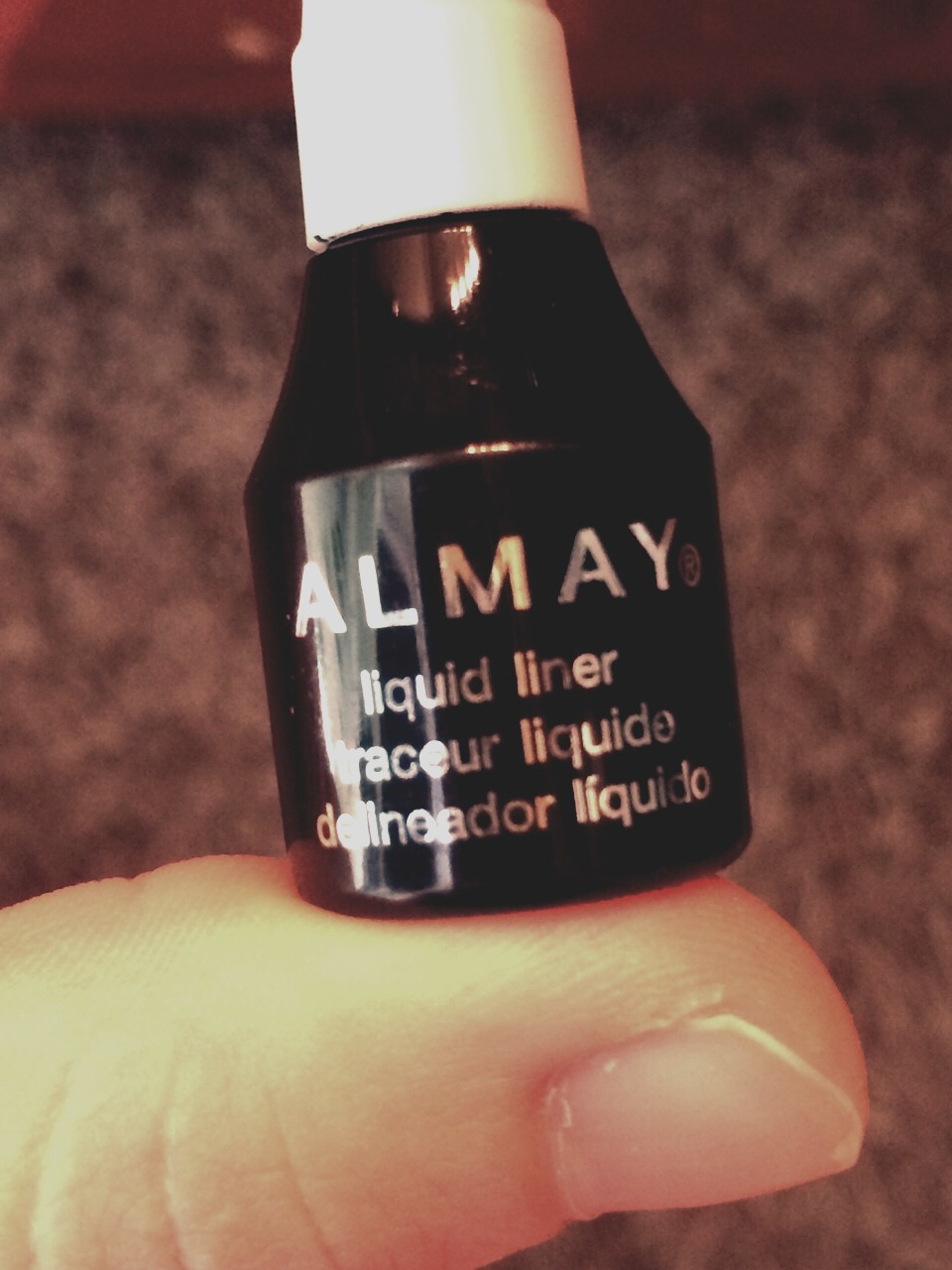 Take any liquid eyeliner of your choosing. It does not matter the color or brand. I prefer this Almay liquid eyeliner in black.