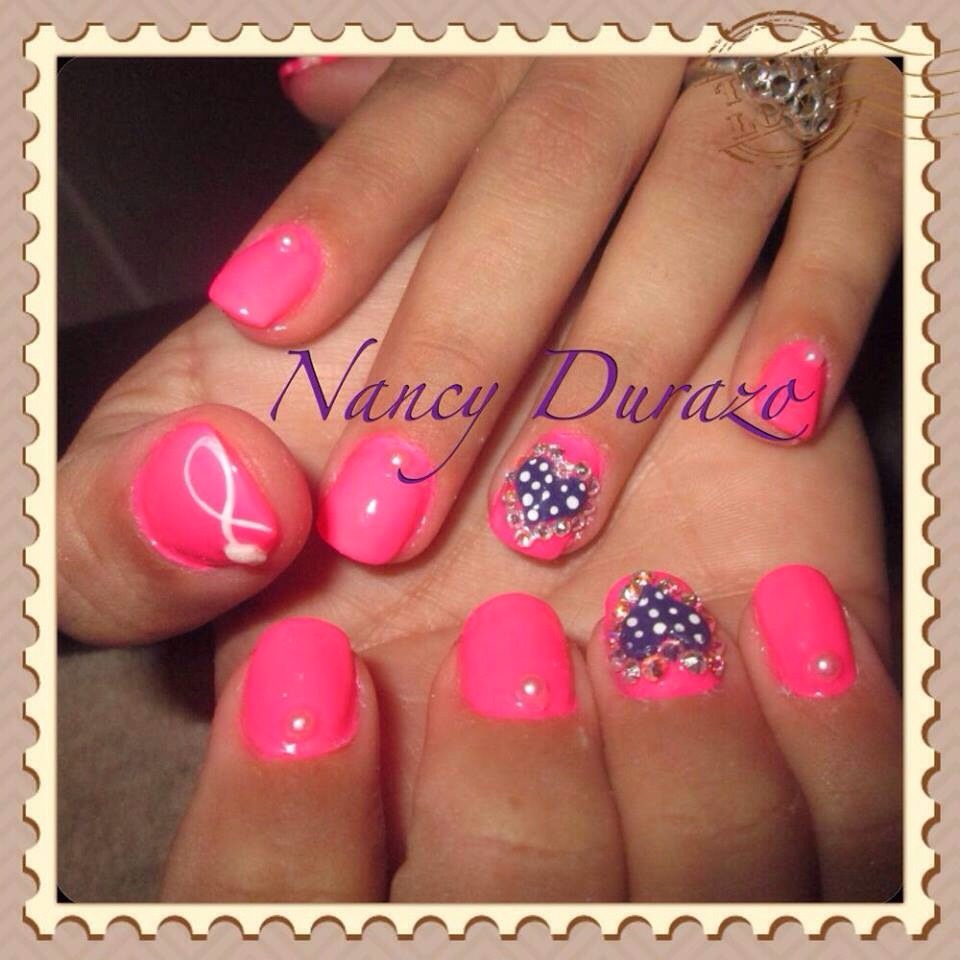 Hott pink with purple hearts with white pokadots! Bling around the heart for some shine and some pearls on my other nails 💎💅💜