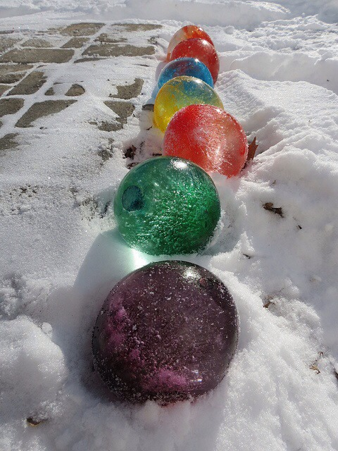 Fill balloons with water and add food colouring once frozen cut the balloon off and the balloons look like giant marbles use Christmas colours if you wish for fun with the kids !