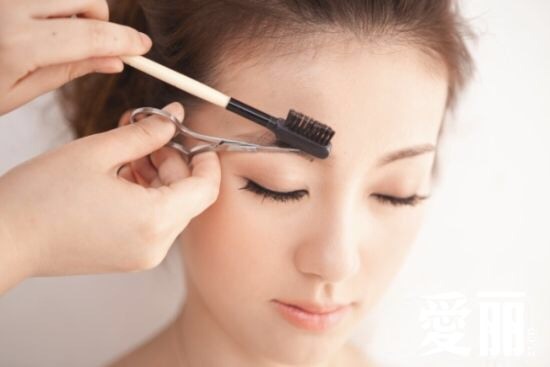 Use an eyebrow brush to comb out and up, then use a pair of clean moustache or nail scissors to trim down the long hairs that stand out. Don't cut them too short, or they'll stand up even more. Just make sure they blend with the rest of your brows when they're combed up, and you'll be fine.