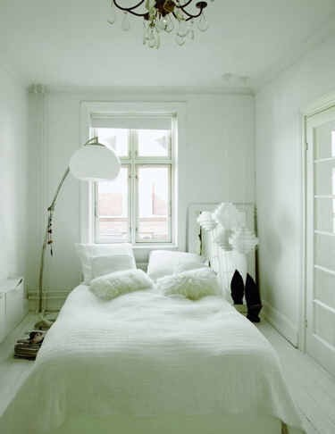 16. You can skip the headboard in favor of a few inches of more floorspace.