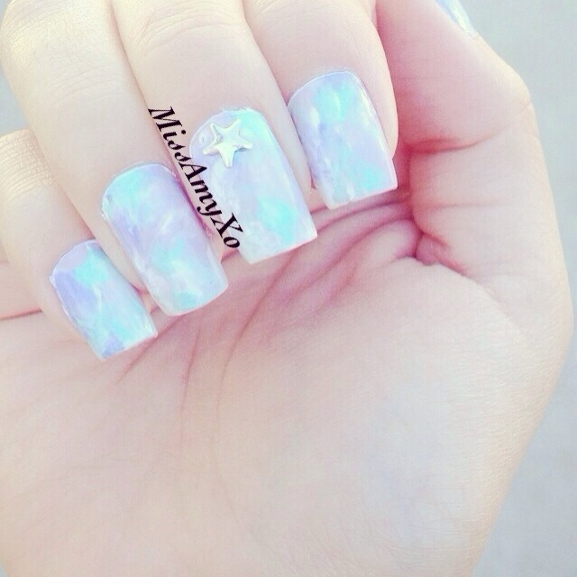 Simple pastel nails using a white polish as a base. A zip lock or wrapping paper choose 4 to 5 colors of your choice blob them onto the nail then with the plastic over the nail your lightly tap it mixing the colors for this effect 😉