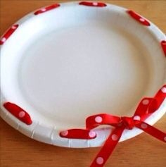 Make it yourself, paper plates, hole puncher and ribbon! You can use different colours and sizes of plates!