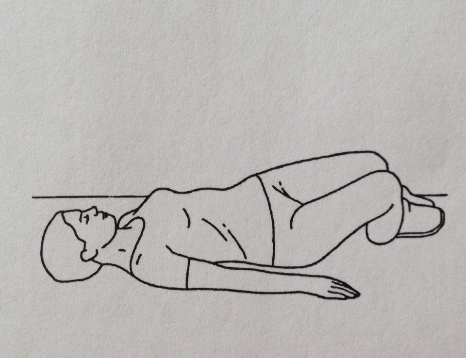 Lying on your back with knees together and bent: Slowly roll your knees from side to side keeping your upper trunk still. Repeat 10 times.