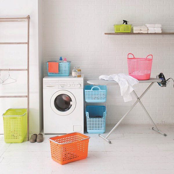 12. Use stackable laundry baskets for easy sorting, that you can also carry to the washing machine. Get coloured ones or decorate them yourself!