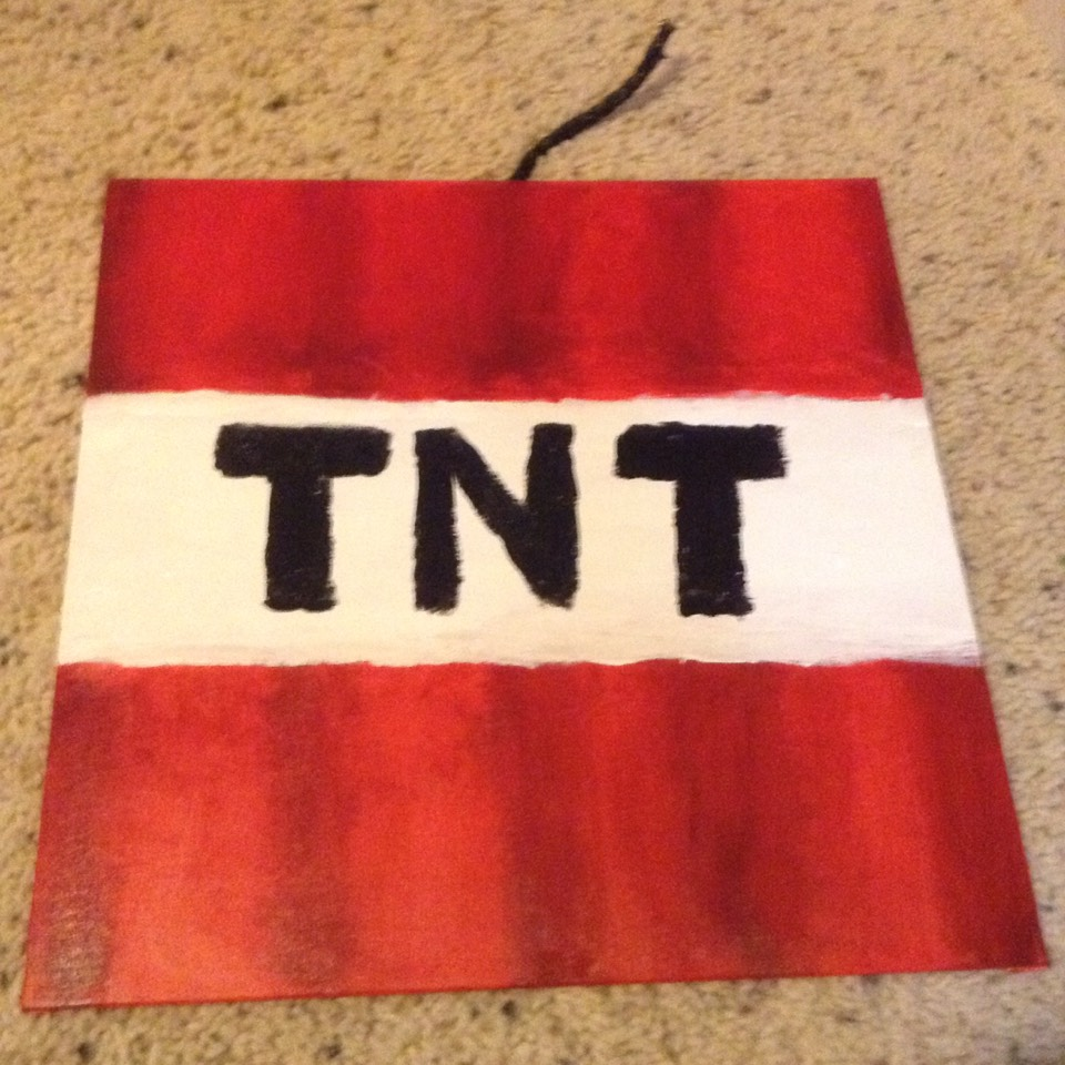 Try to mix in brown or dark red paint in lines. ( paint lines and try to blend them ) After white drys, try your best to paint TNT on in black as if it was in the game. It's also optional to paint string black with paint and glue it on the back.
