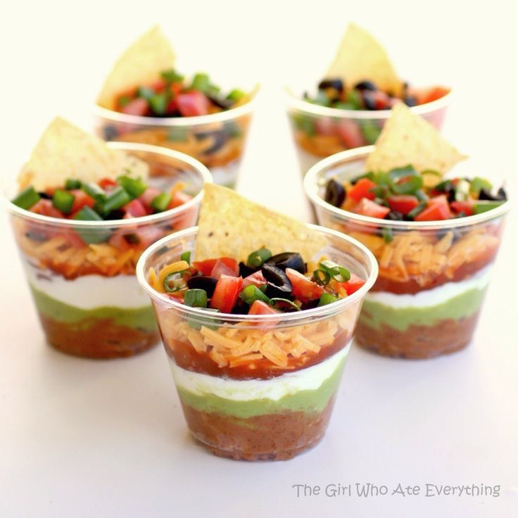 Easy party snack!  Retried beans, guacamole, sour cream, salsa and cheese in a cup! Add a couple tortilla chips to eat it with!  Please like :)