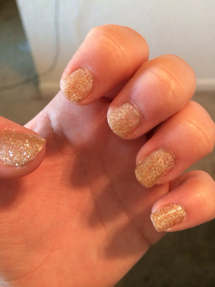 Put gold sparkles over the base coat