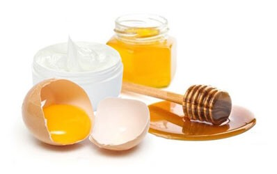 Massage honey with egg yolk into the scalp and hair. Leave for a 1/2 hour, then rinse to prevent hair loss.