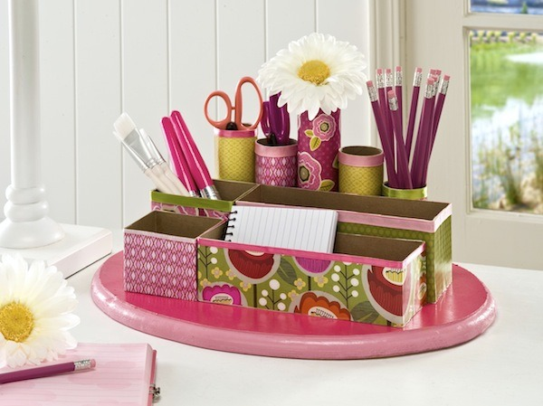 Arrange the cereal boxes and toilet roll on cardboard then decorate with paint, spare wrapping paper or craft paper :)