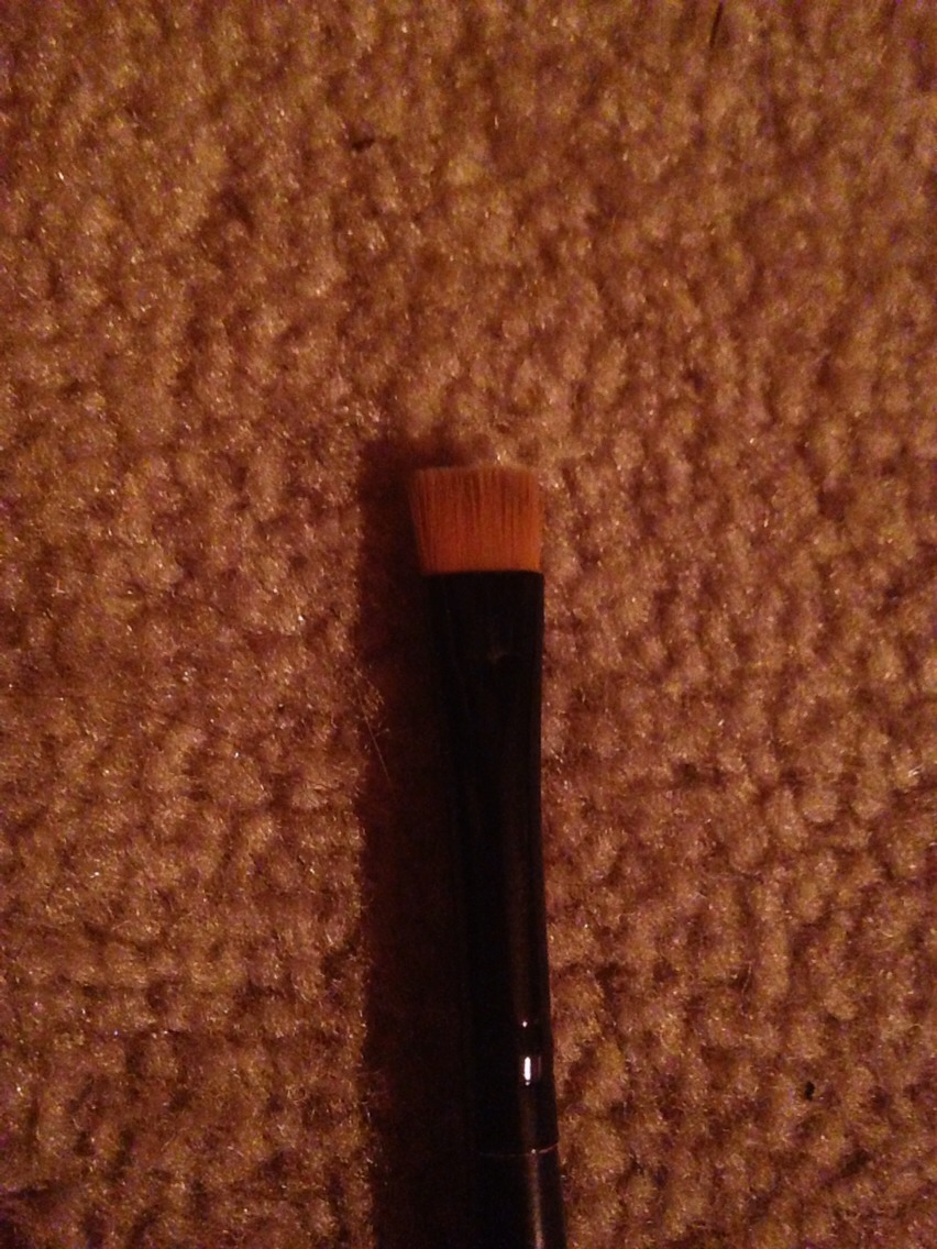 Get a small square tip brush. Eyeliner brushes work great for this! That is the type i am using above.